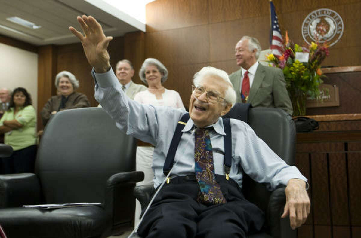 Retired judge Bill Hatten reacts to birthday wishes from former colleagues during a celebration marking his 96th birthday Wednesday in the 176th District Court where he dispensed justice until being forced to step down in 1988 because of his age.