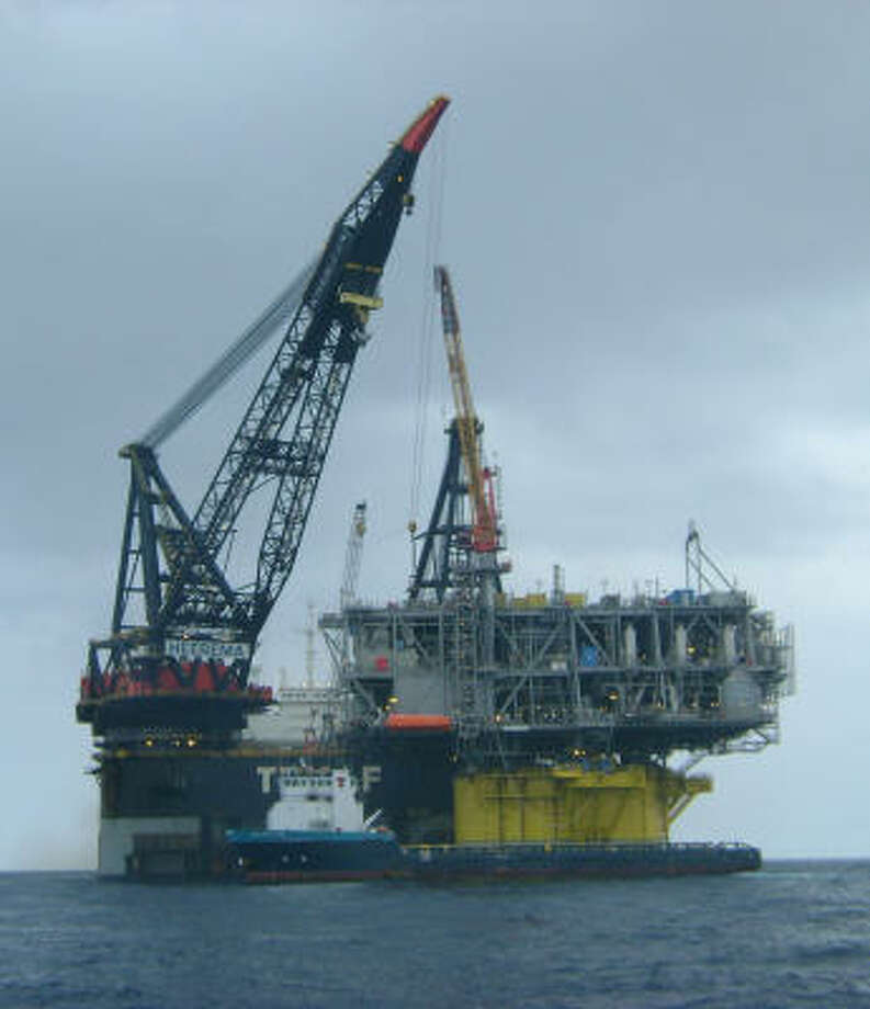 A crane ship completes the installation in March of the topsides portion of the Shell Oil-operated Perdido production and drilling platform in the Gulf of Mexico. Photo: Shell Oil