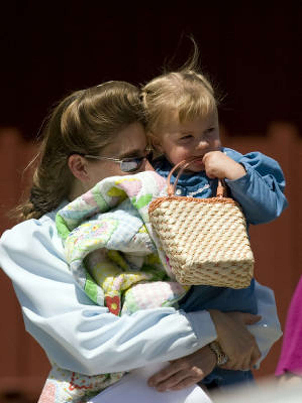 A mother from the Fundamentalist Church of Jesus Christ of Latter Day Saints reunites with her child at the Kidz Harbor facility in Liverpool, Texas, in June 2008. Two months earlier, CPS seized 439 children from the polygamist sect.