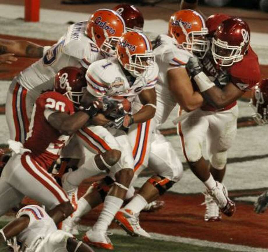 Some BCS critics lament the fact that one-loss Florida and one-loss Oklahoma played for the title last year, while unbeaten Utah did not. Photo: John Raoux, AP