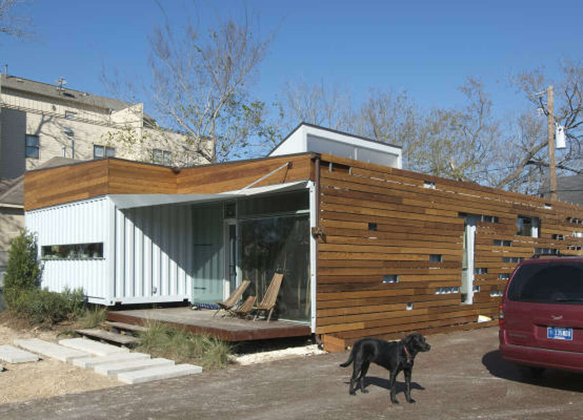 A sustainable wooden screen shades the side of the 206 Cordell house, built by Numen Development in 2008.