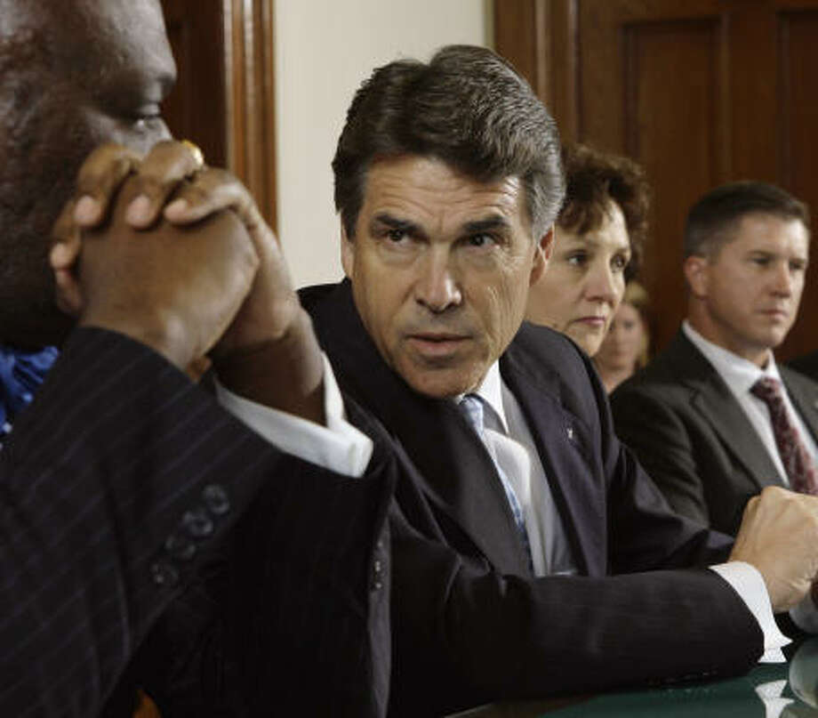 "Gov. Rick Perry speaks at a meeting with business leaders. ""When I decide on the date (for a special session), I'll let you all know what we're going to discuss, but it's a little bit premature,"" Perry said in Austin on Tuesday. Photo: Harry Cabluck, AP"