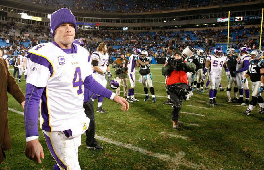 Brett Favre walks off the field after a loss to Carolina, which has combined with a dispute with coach Brad Childress to create a bad week for first-place Minnesota. Photo: Kevin C. Cox, Getty Images