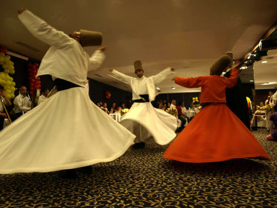 Those unfamiliar with the Whirling Dervishes might think their performance is entertainment, but it is worship for both the participants and Muslim onlookers. Photo: GARY GREENBLUM :, FOR THE CHRONICLE