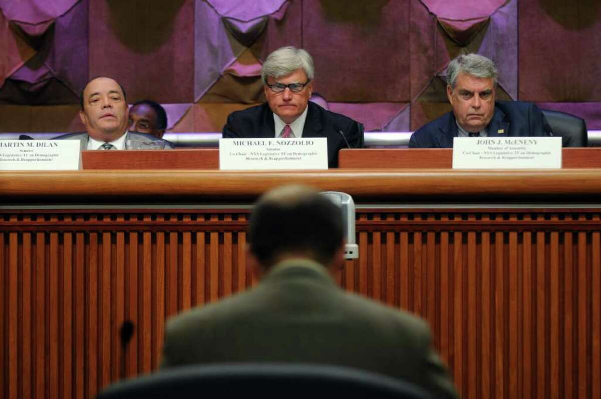 """State Senator Martin Dilan, left, State Senator Michael Nozzolio, center, and Assemblyman John """"Jack"""" McEneny, right, listen to Albany Common Council Member Anton Konev, foreground, speak during a public hearing as part of a state legislative panel on redistricting in the Legislative Office Building on Thursday Aug. 4, 2011 in Albany, NY. (Philip Kamrass / Times Union)"""