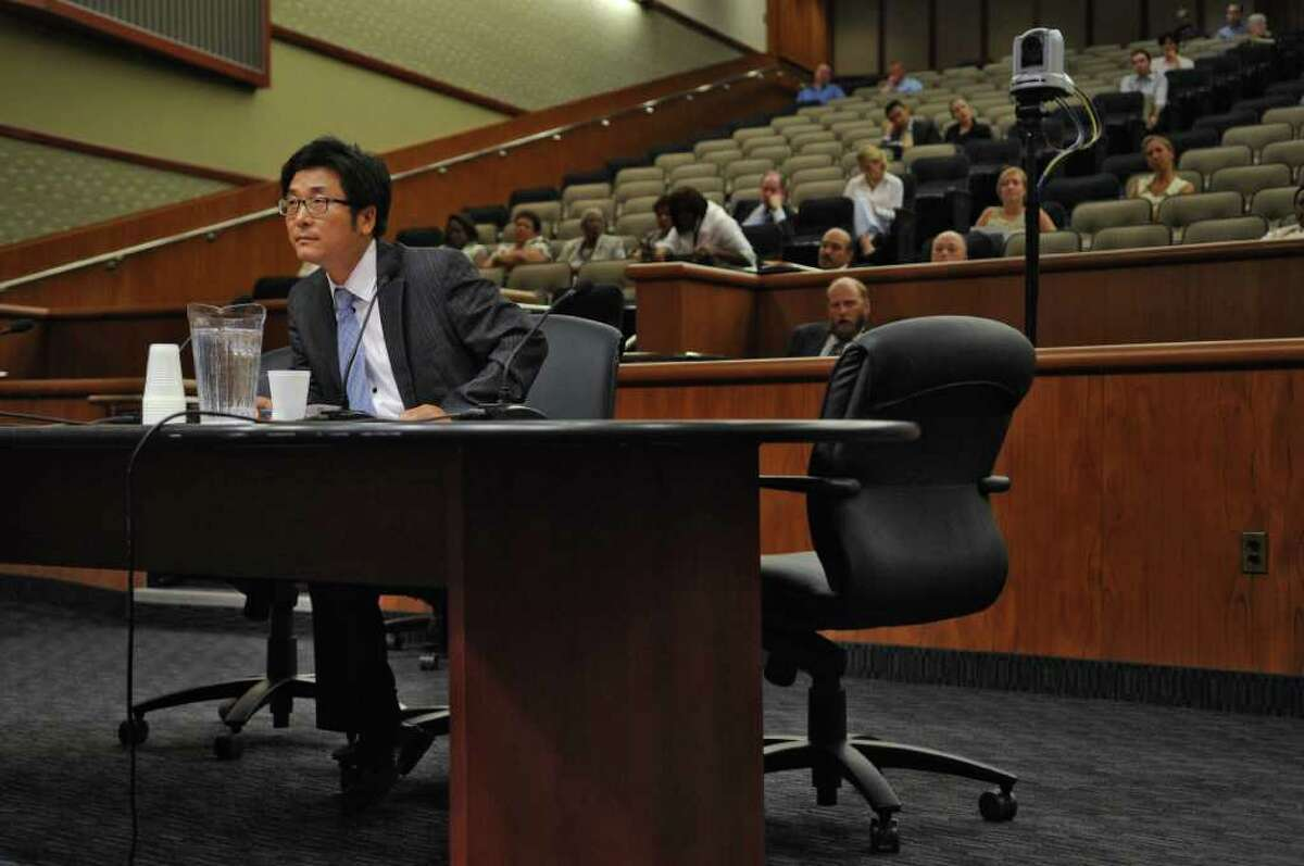 Chejin Park, Staff Attorney, Voting Rights Coordinator of the Korean American Voter's Council, after speaking during a public hearing as part of a state legislative panel on redistricting in the Legislative Office Building on Thursday Aug. 4, 2011 in Albany, NY. (Philip Kamrass / Times Union)