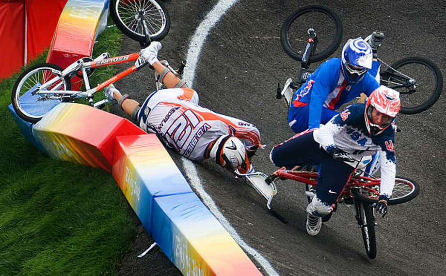 Kyle Bennett (88) of Conroe, Texas, tumbles during the quarterfinals of BMX cycling. Photo: Smiley N. Pool, Houston Chronicle