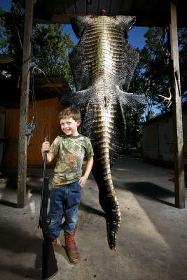 At age 5, Simon Hughes is no stranger to hunting. His first big trophy — a 12-foot-6, 800-pound alligator, may be hard to top, though. Photo: Michael Paulsen, Chronicle