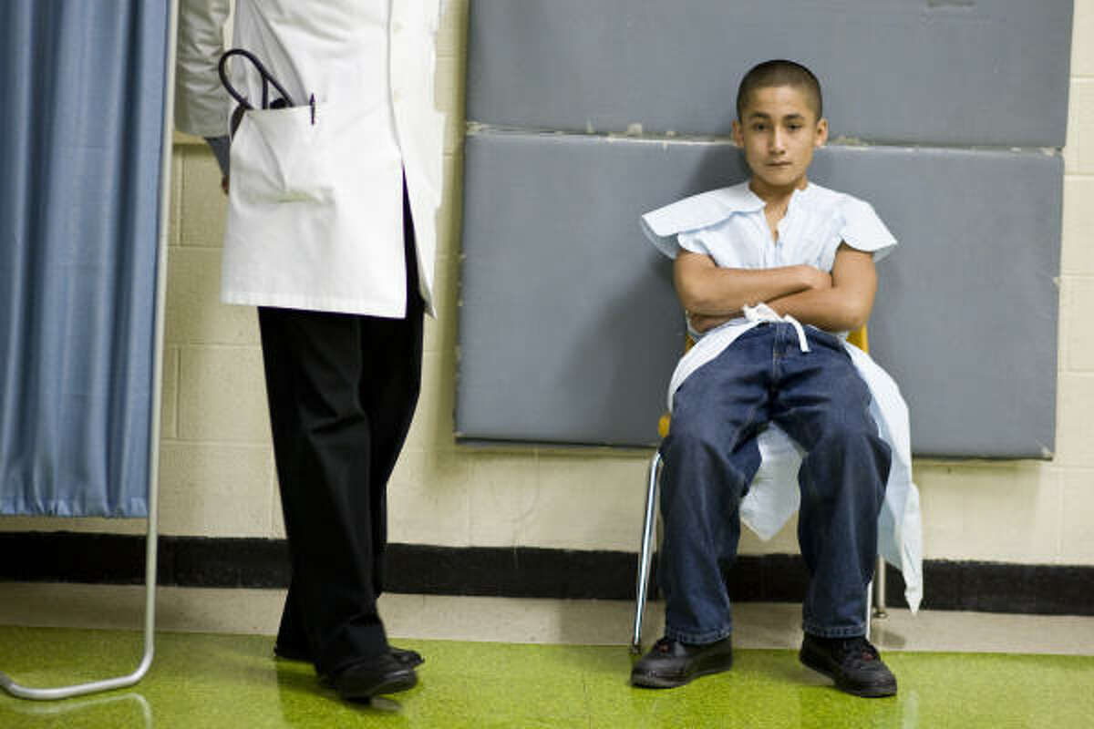 Sixth-grader Alexis Guzman, 12, waits to be dismissed Wednesday after undergoing a free heart screening at Lamar Fleming Middle School in Houston.