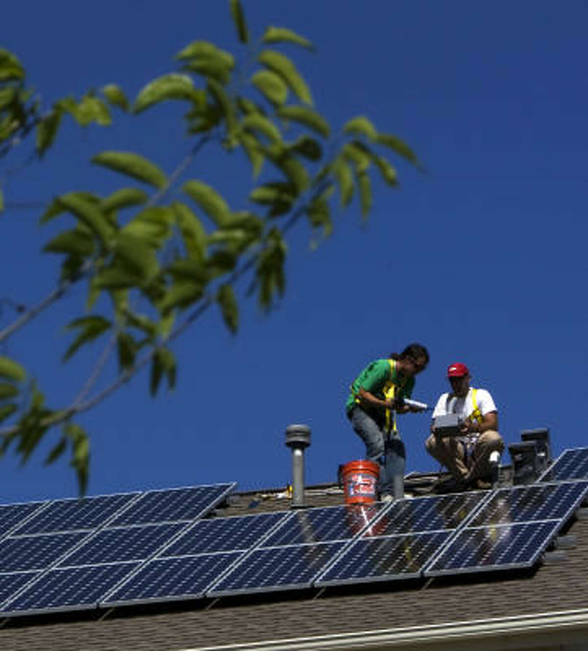 Solar panels are installed this spring at a house in Houston.