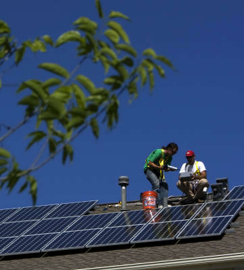 Solar panels are installed this spring at a house in Houston. Photo: Johnny Hanson, Chronicle