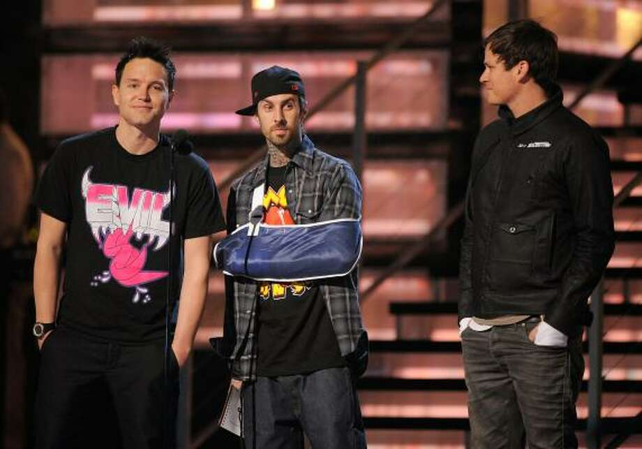 Mark Hoppus, from left, Travis Barker and Tom DeLonge broke the news of a blink-182 reunion during the 51st annual Grammy Awards in February. It was the first time the three appeared onstage since 2004. Photo: Mark J. Terrill :, Associated Press