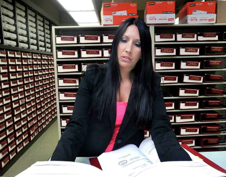Danbury Town Clerk Lori Kaback reviews public records that she may not be able to release as a result of a recent state Supreme Court ruling. The issue has limited the flow of public information, Thursday, Aug. 4, 2011. Photo: Michael Duffy