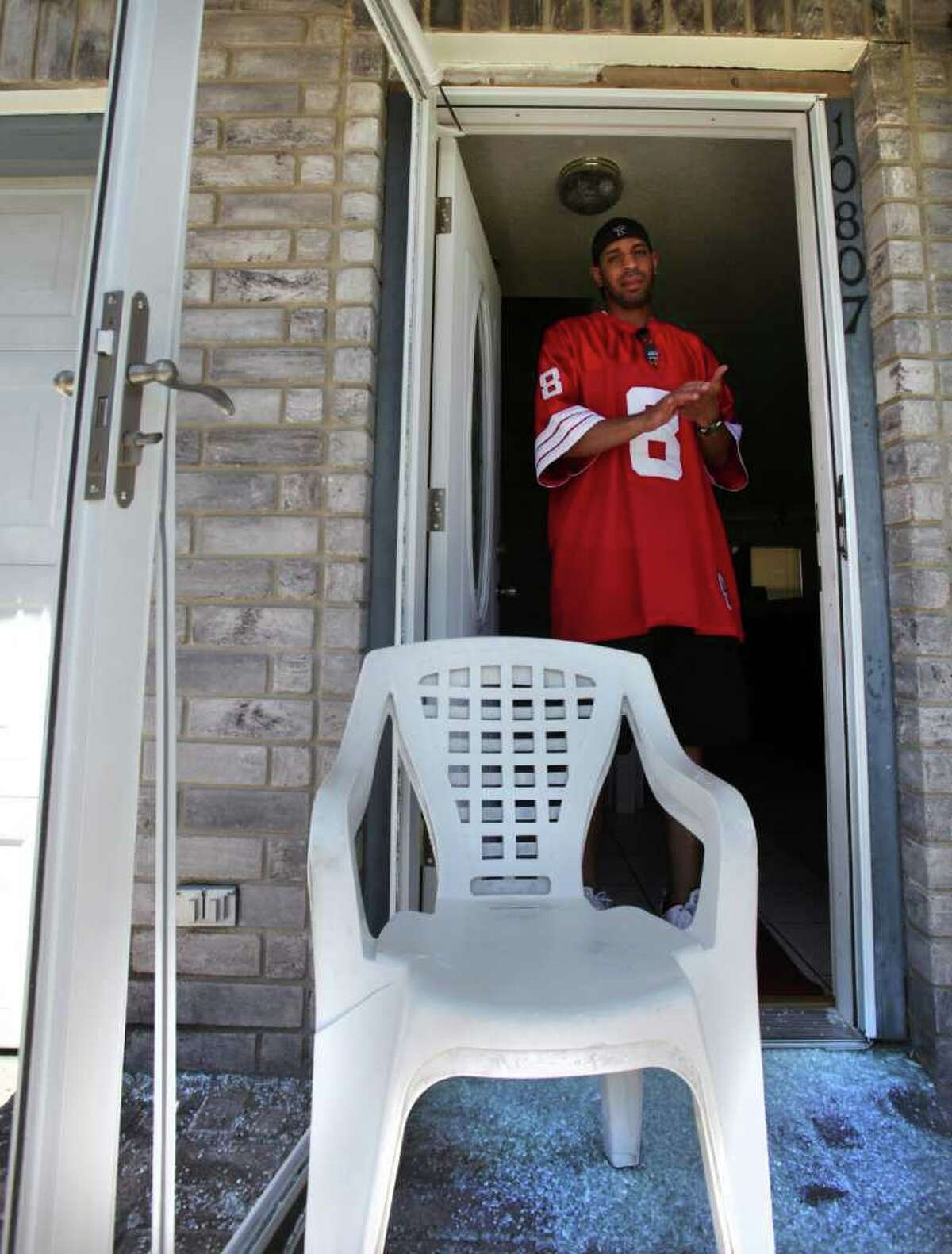 Kenneth Watson looks out the door that was shattered during a struggle between police officers and Watson's nephew Pierre T. Abernathy who received multiple Tasings from police. Abernathy died in police custody during transport to SAPD. Thursday, August 4, 2011.