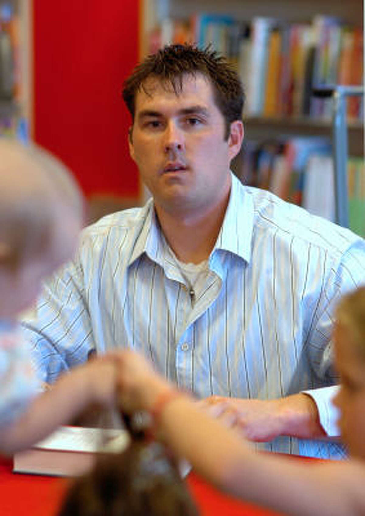 Marcus Luttrell, shown at a book signing, said the attack on his dog pushed him into a place he didn't want to be in.