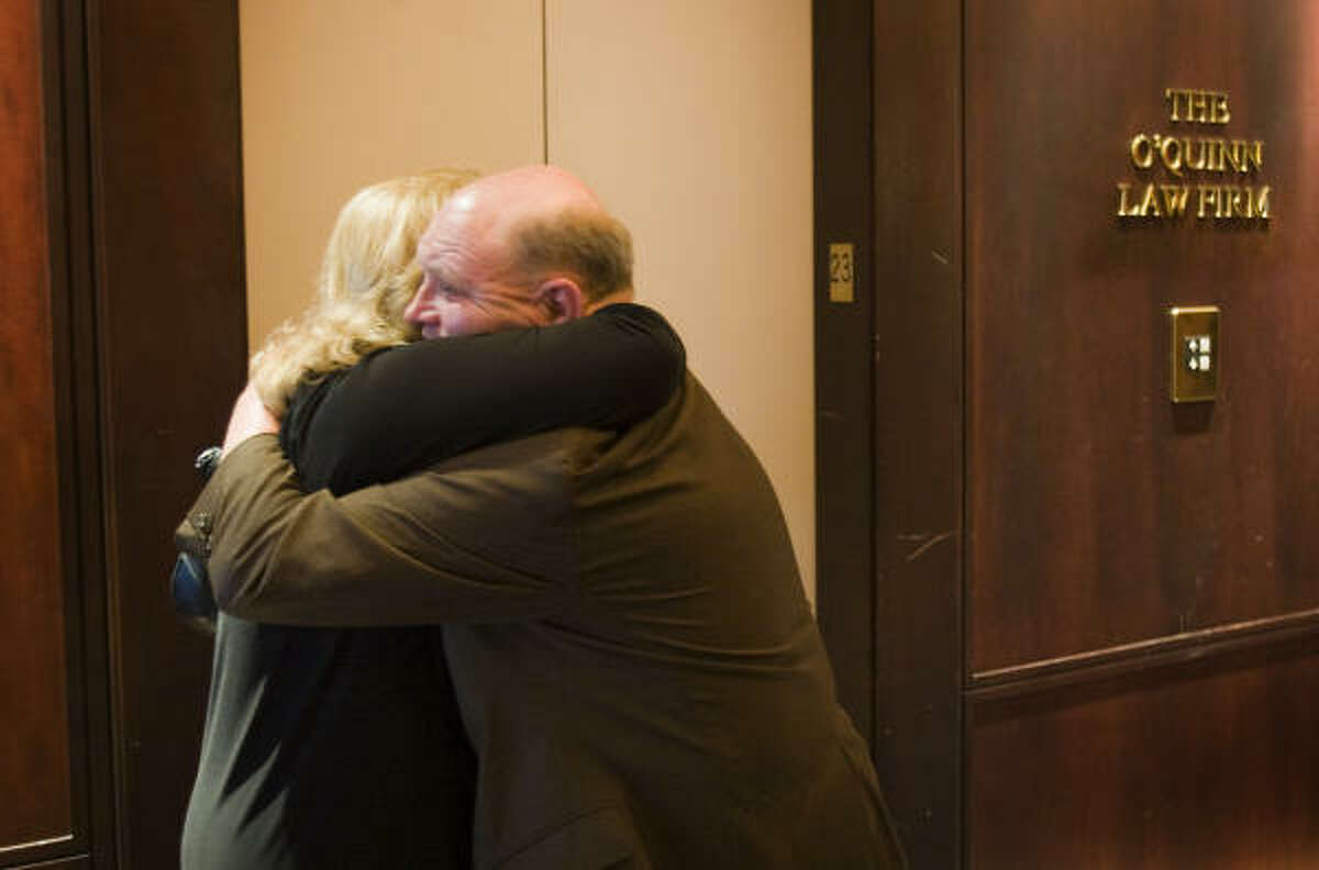 Colleagues mourn at the downtown offices of John O'Quinn's law firm on Thursday.