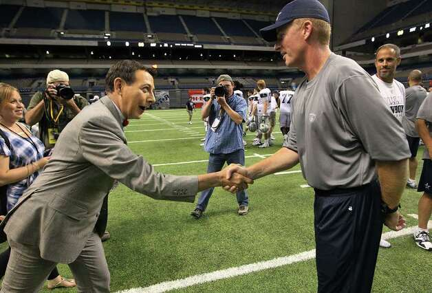 Comedian Pee Wee Herman (left) shakes hands with Cowboys head coach Jason Garrett at the evening session of the Dallas Cowboys training camp at the Alamodome on Thursday, Aug. 4, 2011. Kin Man Hui/kmhui@express-news.net Photo: KIN MAN HUI, -- / SAN ANTONIO EXPRESS-NEWS