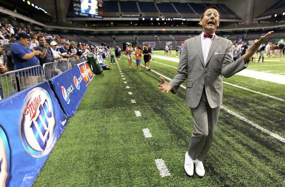 Comedian Pee Wee Herman reacts to fans as he made a visit to the evening session of the Dallas Cowboys training camp at the Alamodome on Thursday, Aug. 4, 2011. Kin Man Hui/kmhui@express-news.net Photo: KIN MAN HUI, -- / SAN ANTONIO EXPRESS-NEWS