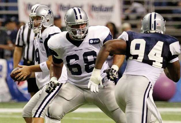 Offensive lineman Doug Free (68) protects quarterback Tony Romo (left) from linebacker DeMarcus Ware (94) during the evening session of the Dallas Cowboys training camp at the Alamodome on Thursday, Aug. 4, 2011. Kin Man Hui/kmhui@express-news.net Photo: KIN MAN HUI, -- / SAN ANTONIO EXPRESS-NEWS