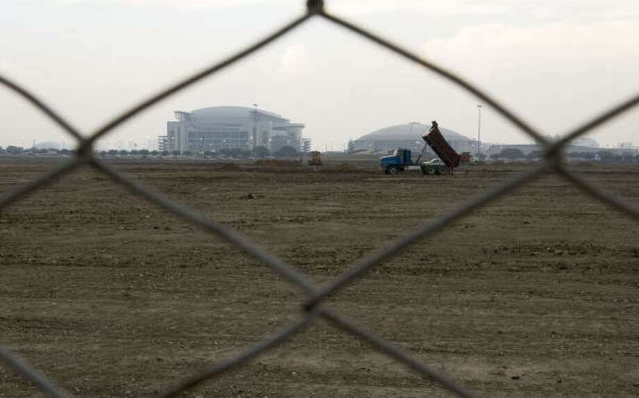 AstroWorld ceased to be on this date in 2005. The land awaits redevelopment. For now, you may park here during the RodeoHouston season. Photo: Brett Coomer :, Chronicle