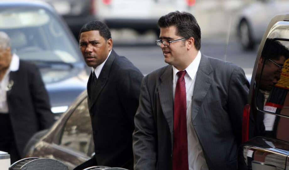Astros' Miguel Tejada, left, arrives at Federal Court in Washington to answer charges of lying to Congress. Photo: Pablo Martinez Monsivais, AP