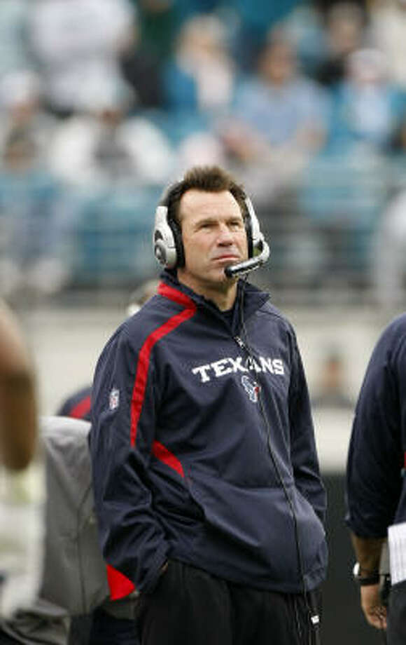 Texans head coach Gary Kubiak watches a replay of a Chris Brown pass that was intercepted in the fourth quarter against the Jaguars. Photo: Nick De La Torre, Chronicle
