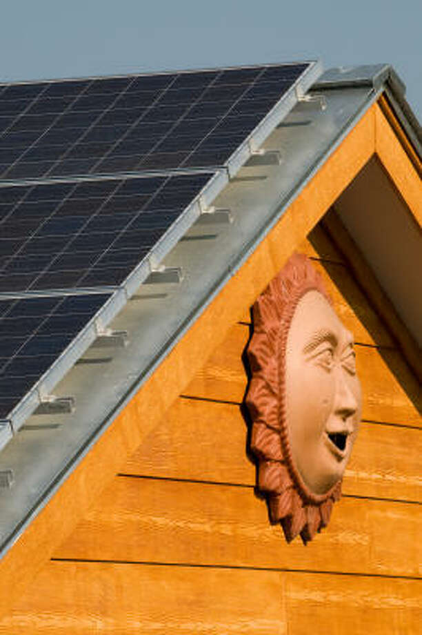 Energy-efficient buildings, like this Austin home fitted with solar panels, could drop electricity demand. Photo: Mark Matson, For The Chronicle