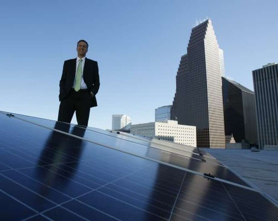 Cris Eugster, Houston's officer of sustainable growth, helped acquire solar panels for the roof of the City Hall Annex building because the panels will save the city money. Photo: JULIO CORTEZ, CHRONICLE