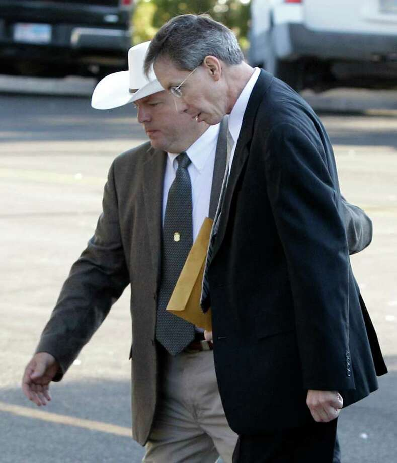 A law enforcement officer, left, escorts polygamist religious leader Warren Jeffs, right, into the Tom Green County Courthouse Thursday Aug. 4, 2011, in San Angelo, Texas.  The defense rested Thursday in the sexual assault trial against Jeffs in which he served as his own defense. (AP Photo/Tony Gutierrez) Photo: Tony Gutierrez, STF / AP