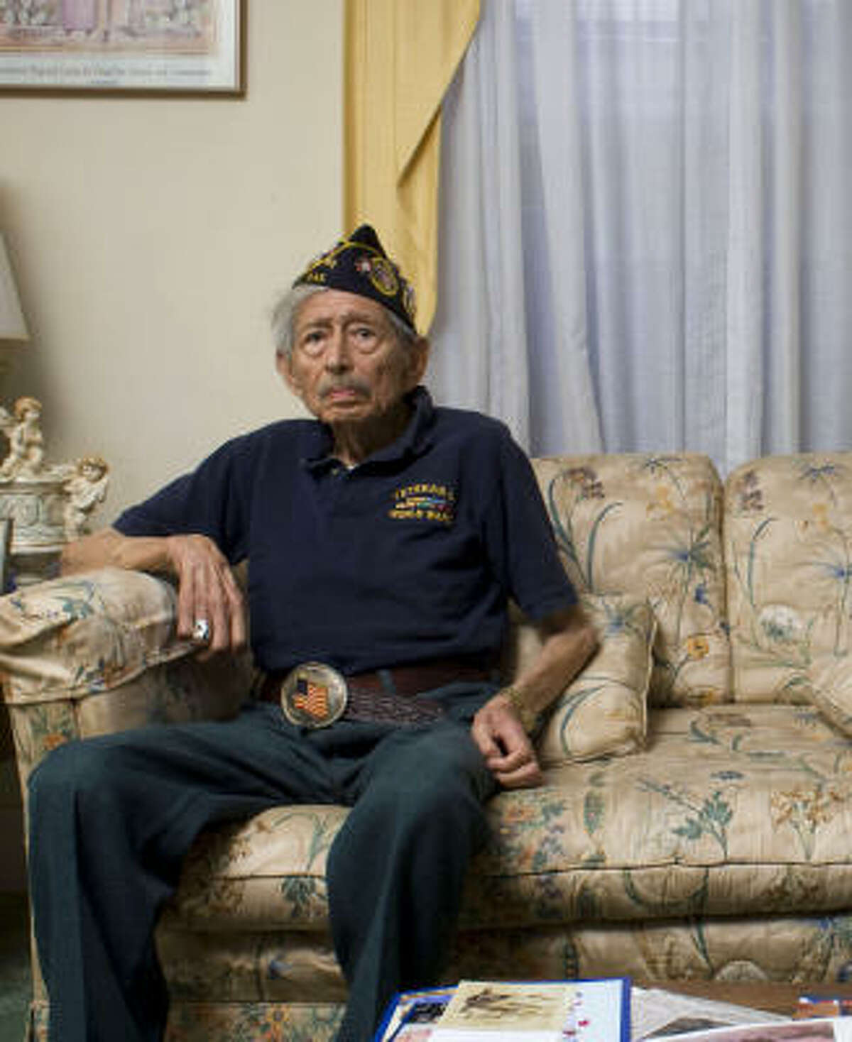 """Jesse Campos, 88, shown at his Houston home, says his friends call him """"Lucky Leg"""" because he was wounded twice in the same leg."""