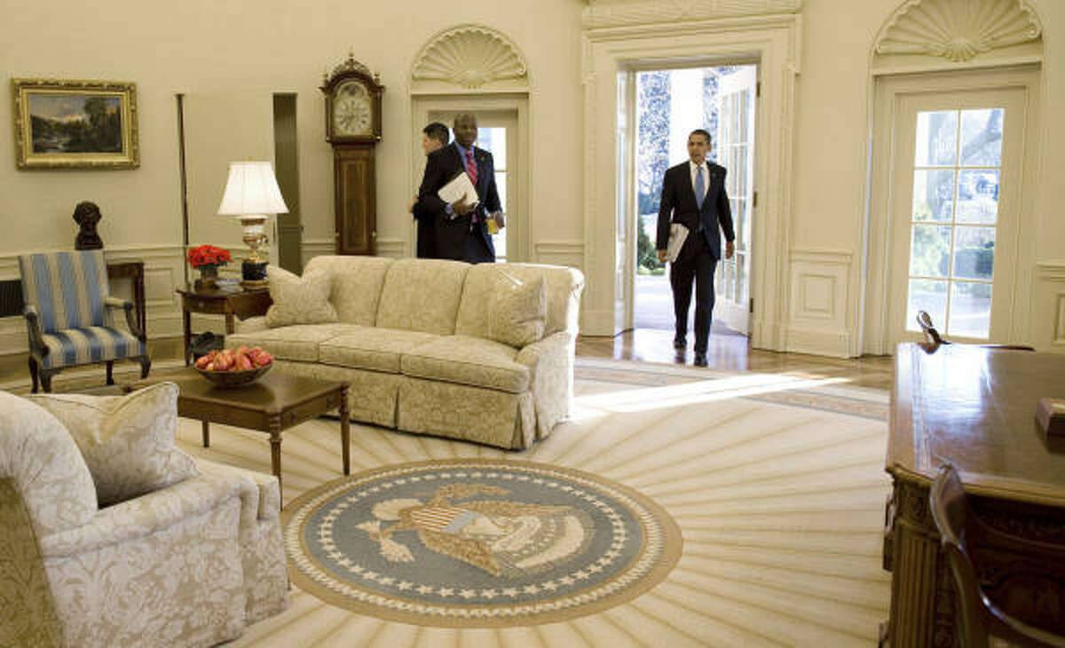 READY TO WORK: In this handout photo provided by the White House, President Barack Obama walks into the Oval Office on Wednesday, the first complete day of his administration, after attending a prayer service at Washington National Cathedral.