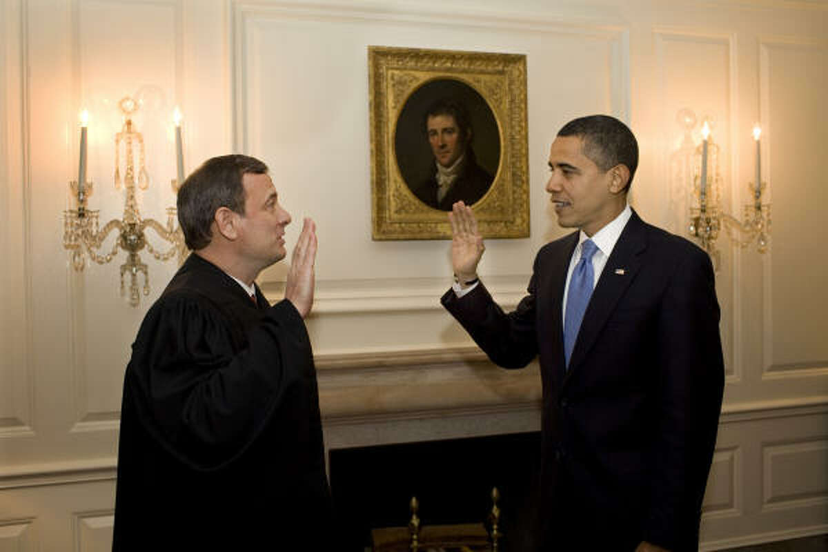 DO-OVER: In a handout photo taken Wednesday night and provided by the White House, Chief Justice John Roberts readministers the oath of office to President Barack Obama. The original oath at Tuesday's inauguration ceremony had a word out of sequence.
