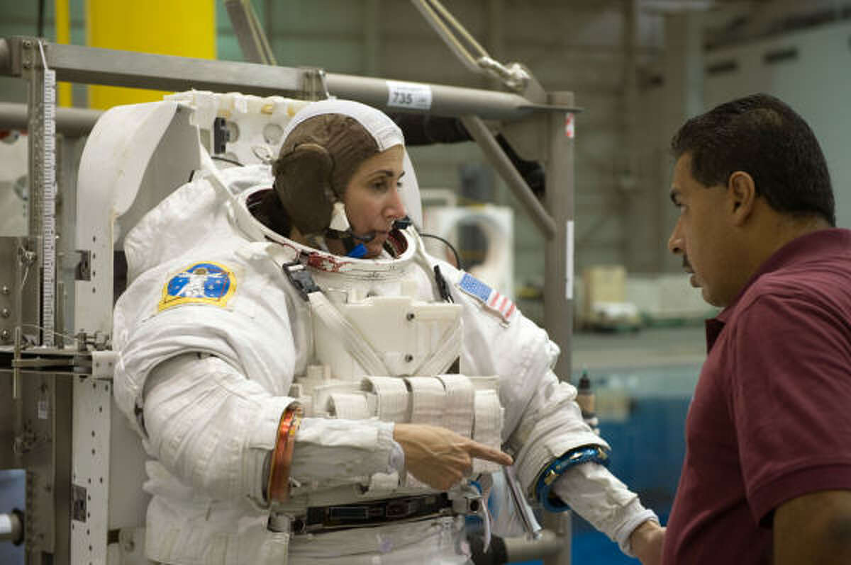 STS-128 crew members Danny Olivas and Nicole Passonno Stott during a training session.