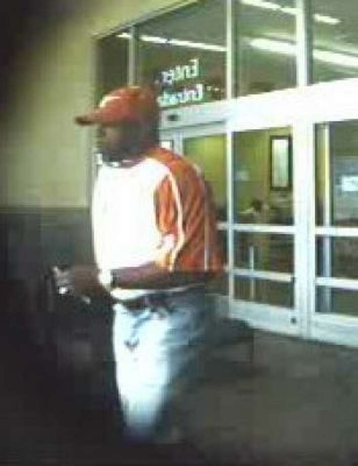 Police suspect this man of using fake identification to bilk several Walmart stores out of thousands of dollars. Photo: Surveillance Photo