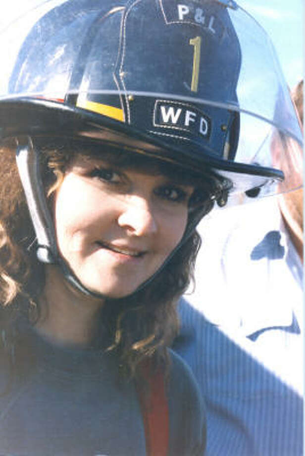 Marla Buschardt was a firefighter, trail rider and a collector of antique fire engines. Photo: Family Photo