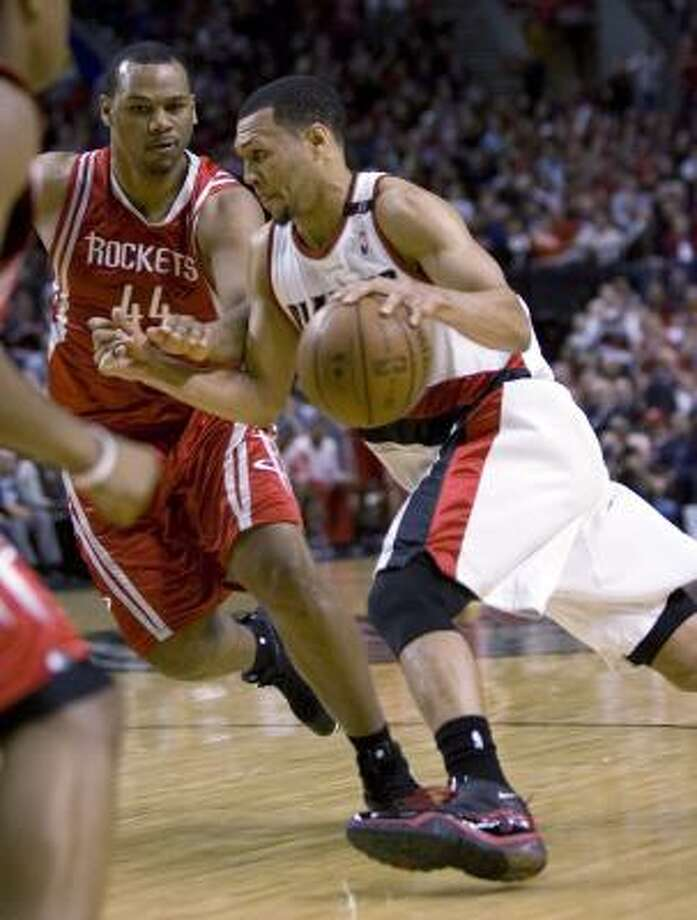 Brandon Roy, right, shown alongside Rockets forward Chuck Hayes in Game 5, and teammates are trying to become just the ninth NBA team — and the first since Phoenix rallied to beat the Lakers in 2006 — to come back and win a playoff series after being down 3-1. Photo: Don Ryan, AP