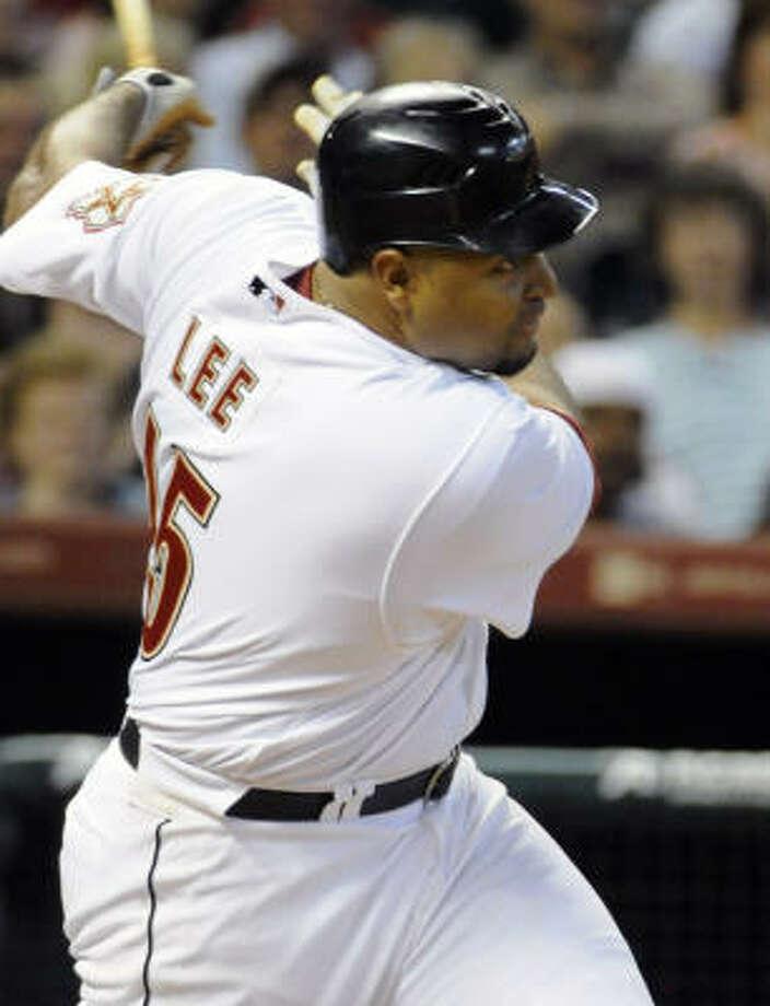 Astros left fielder Carlos Lee follows through on his RBI single in the sixth inning. Photo: Pat Sullivan, AP