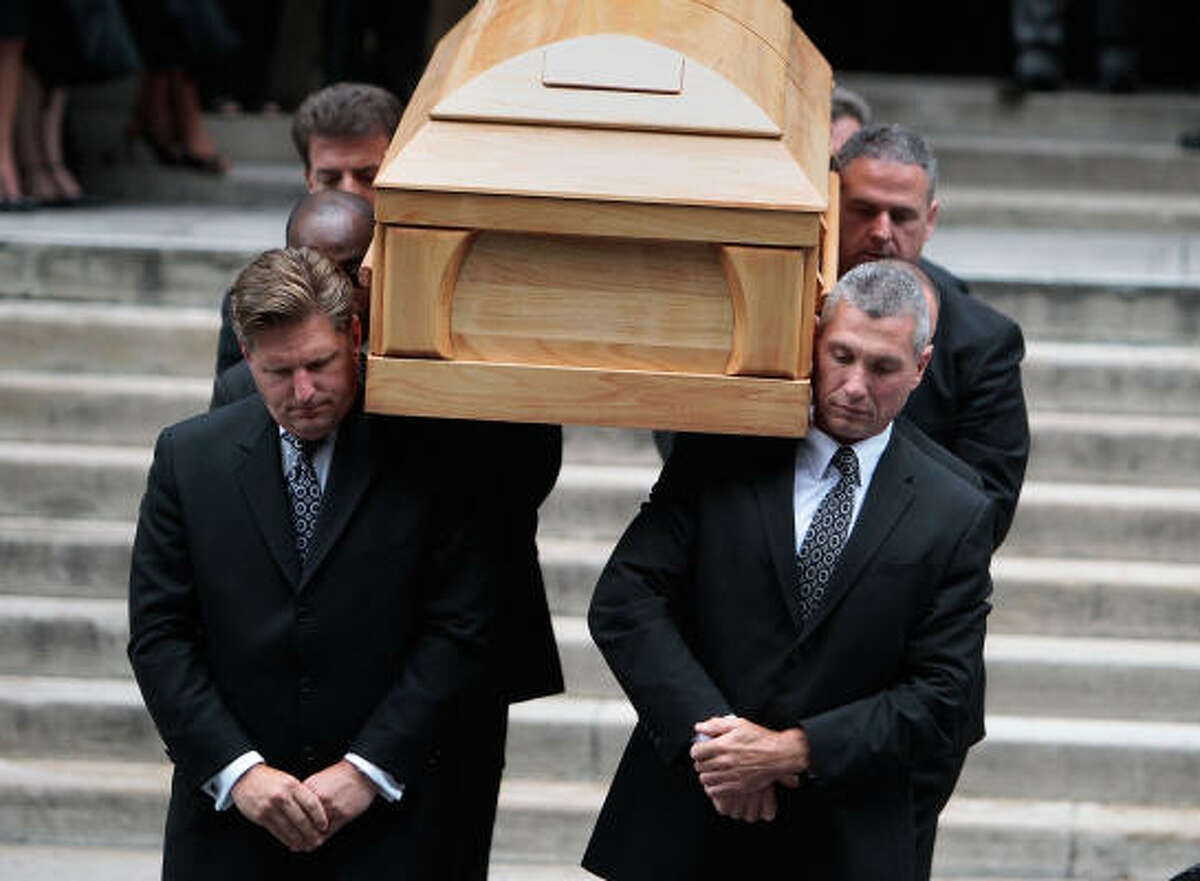 Pallbearers carry the casket of celebrated newsman Walter Cronkite after his funeral in New York City on Thursday.