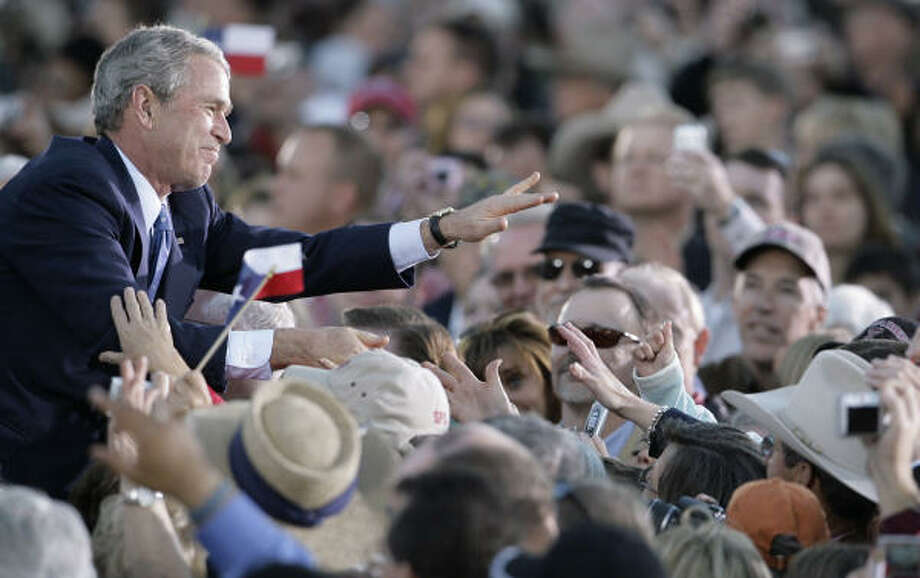 "HOME AGAIN: Former President George W. Bush greets the crowd after a ""Welcome Home"" rally Tuesday in Midland. Photo: Matt Slocum, AP"