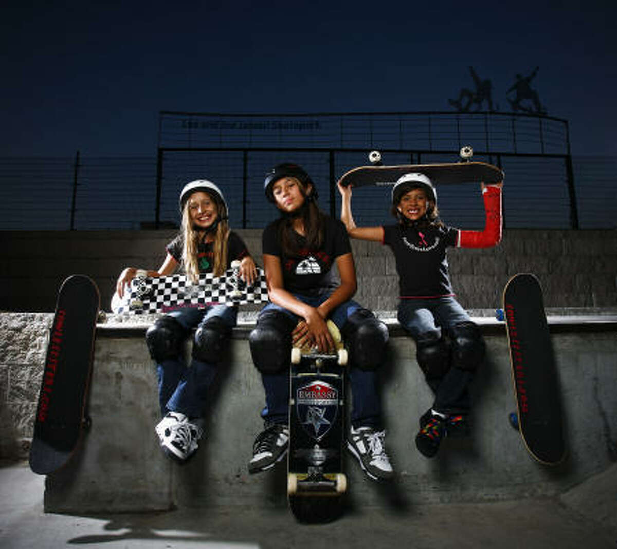"""The """"Sowle Sisters"""" — Valiant, 10, from left, Magnificent, 14, and Gentle Sowle, 8, — have been to the skate park every day since getting boards for Christmas and have quickly made skating the center of their lives."""