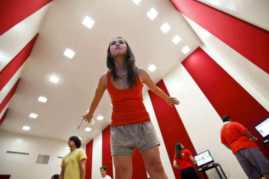 Christy Lee, a University of Houston senior nutrition major, practices her yoga poses using a Wii Fit during a Wii Performance class. Photo: Michael Paulsen, Chronicle