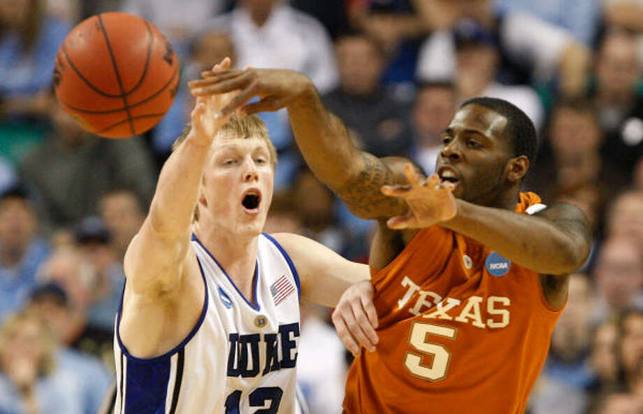 Duke's Kyle Singler, left, attempts to disrupt a pass by Texas' Damion James in the first half. Photo: Streeter Lecka, Getty Images