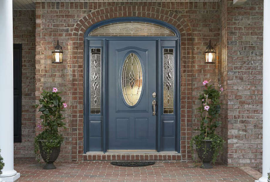 WELCOME: You can shape up your front door for less than you imagined. Bright lights and beautiful color will put your guests at ease when they come knocking. Photo: Paul Baucom