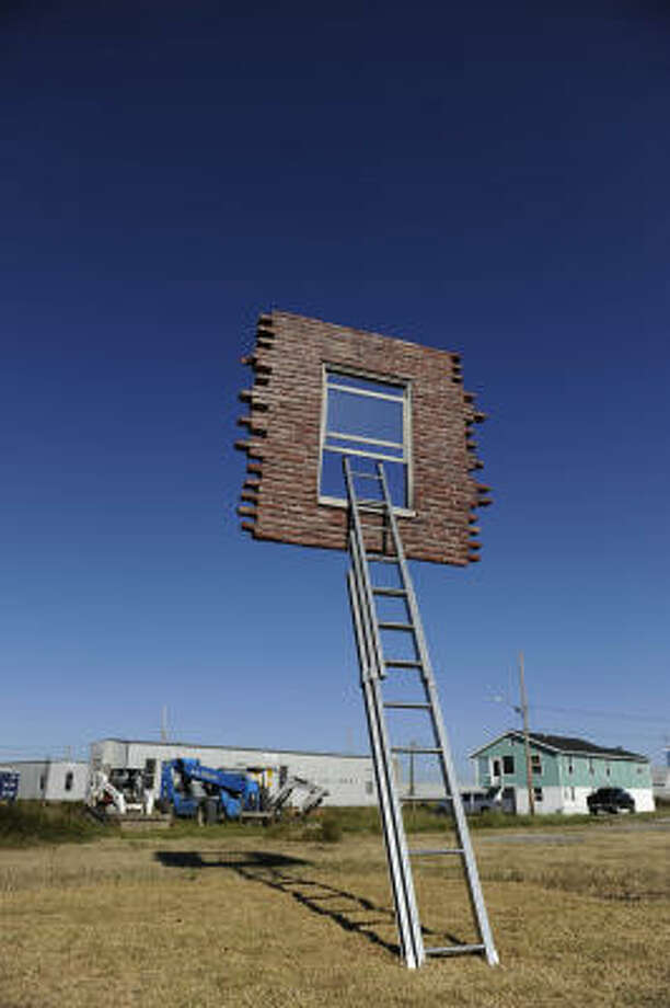 Prospect1 biennial artwork Window and Ladder -Too Late for Help by Leandro Erlich stands tall in the Lower Ninth Ward in New Orleans. Photo: Cheryl Gerber, For The Chronicle