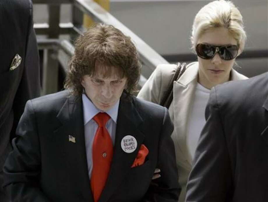 Phil Spector's wife, Rachell, accompanied him to a  Los Angeles court on Monday. Prosecutors said Spector had a history of threatening women with guns. Photo: Nick Ut, Associated Press