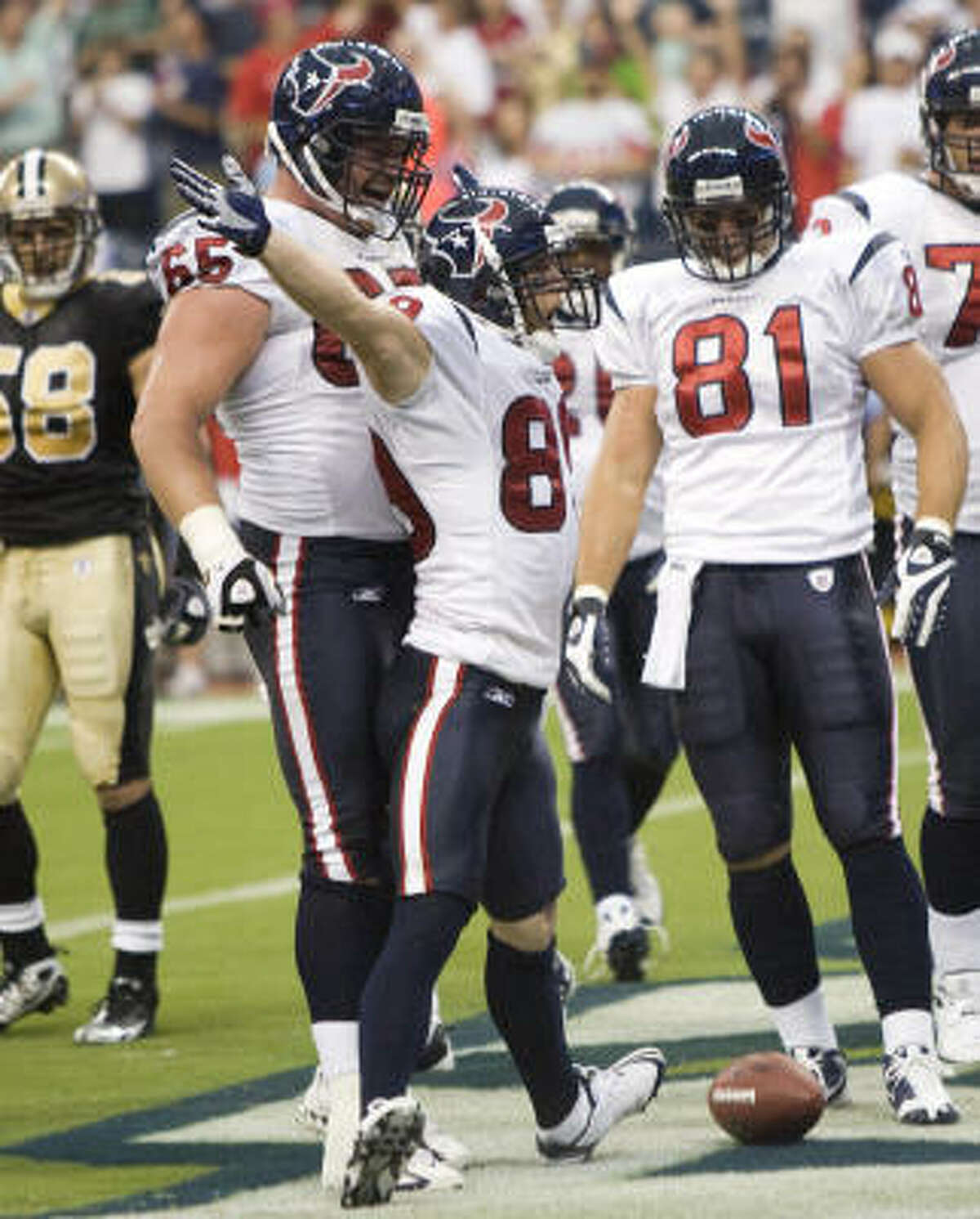 Texans wide receiver David Anderson celebrates his eight-yard touchdown reception from Matt Shaub during the first quarter.