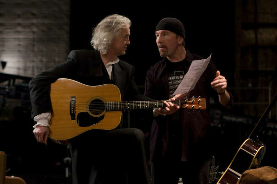 Jimmy Page of Led Zeppelin, left, and and the Edge from U2 compare notes in It Might Get Loud. Photo: Eric Lee, : Sony Pictures Classic