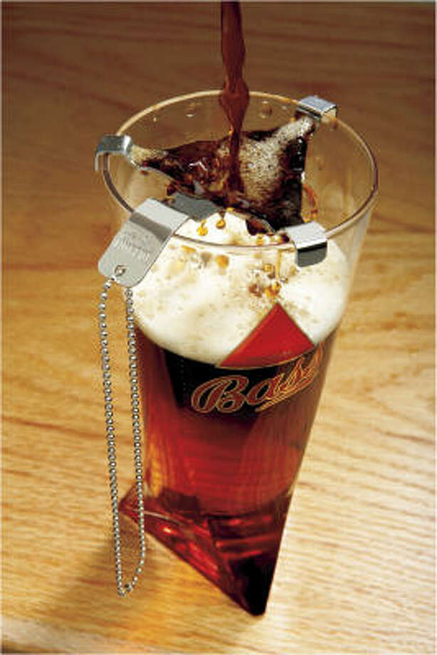 The triangular Bass Brolly is designed to help create layered beer drinks. Photo: JULIA EWAN :, WASHINGTON POST