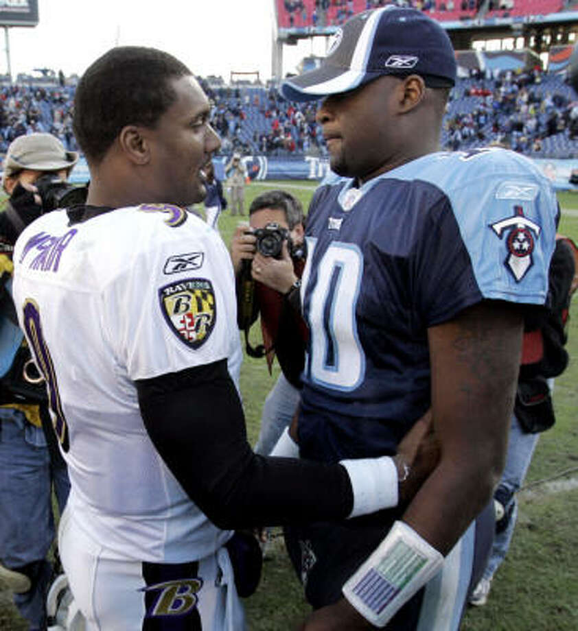 Ravens quarterback Steve McNair, left, and Titans quarterback Vince Young meet on the field after a game in 2006. Photo: MARK HUMPHREY, AP