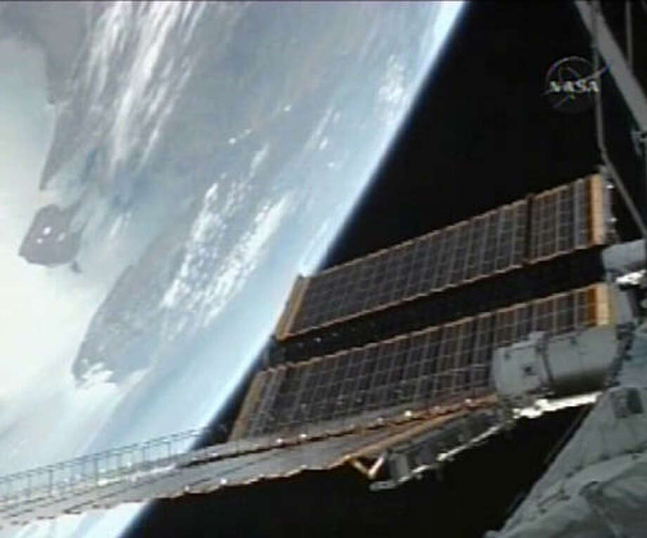 The international space station begins the process of opening its final set of new solar wings. The solar wings belong to the newest power module, which was installed Thursday. Photo: AP